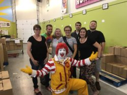 Some of the Food Bank staff enjoys a visit with Ronald McDonald
